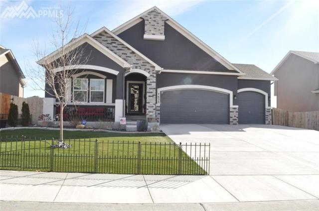 7633 Bonterra Lane, Colorado Springs, CO 80925 (#6352360) :: The Dunfee Group - Keller Williams Partners Realty