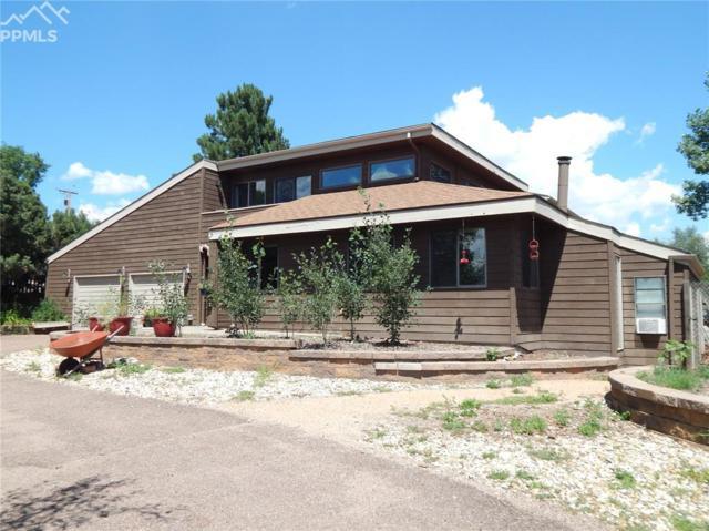 4985 Park Vista Boulevard, Colorado Springs, CO 80918 (#6439525) :: The Kibler Group