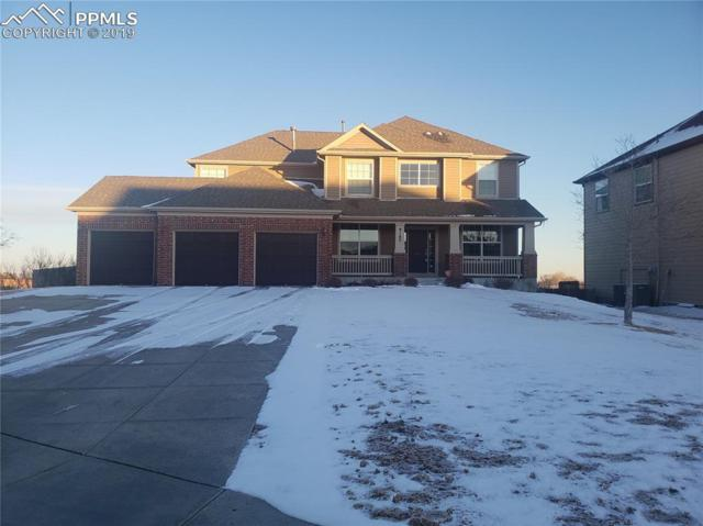 9185 Kingston Heath Road, Peyton, CO 80831 (#6448182) :: The Treasure Davis Team