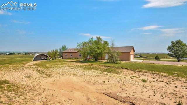 13850 Canter Road, Peyton, CO 80831 (#6571198) :: The Hunstiger Team