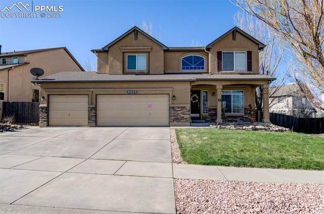 6825 Amber Ridge Drive, Colorado Springs, CO 80922 (#6655547) :: Venterra Real Estate LLC