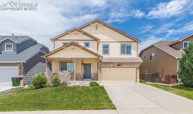 2052 Dewhirst Drive, Colorado Springs, CO 80951 (#6655899) :: Tommy Daly Home Team