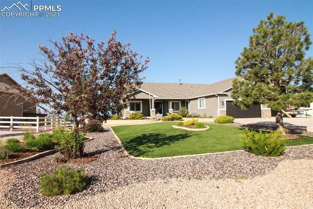 9051 Rockingham Drive, Peyton, CO 80831 (#6661696) :: The Gold Medal Team with RE/MAX Properties, Inc