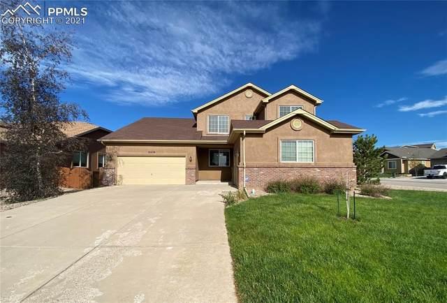 10458 Mount Evans Drive, Peyton, CO 80831 (#6665565) :: The Kibler Group
