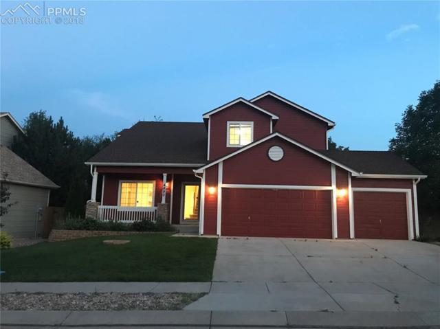 4890 Poleplant Drive, Colorado Springs, CO 80918 (#6668700) :: Jason Daniels & Associates at RE/MAX Millennium