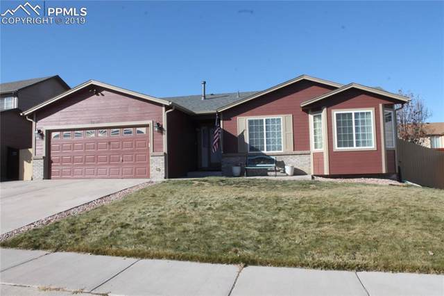 7238 Lone Eagle Lane, Colorado Springs, CO 80925 (#6762047) :: The Hunstiger Team