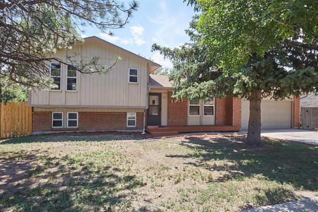 3625 W Montebello Drive, Colorado Springs, CO 80918 (#6838080) :: The Hunstiger Team