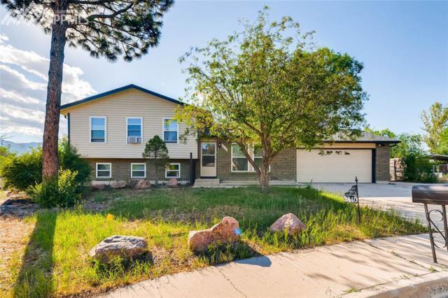 2440 Faulkner Place, Colorado Springs, CO 80916 (#6844856) :: The Treasure Davis Team