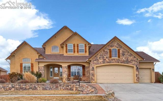 6404 Gunslinger Drive, Colorado Springs, CO 80923 (#6860441) :: The Treasure Davis Team