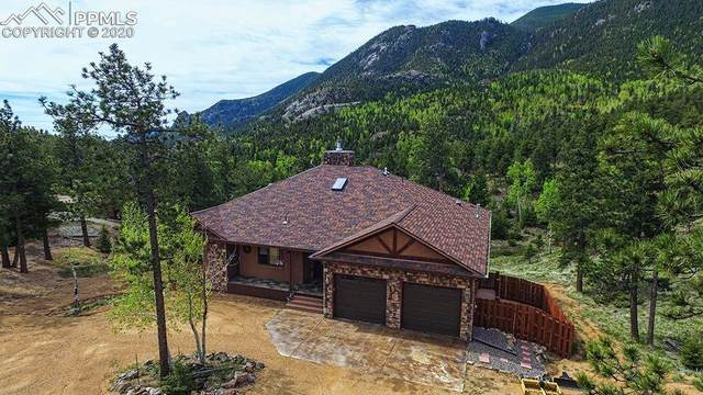 6115 Waterfall Loop, Manitou Springs, CO 80829 (#6911365) :: Tommy Daly Home Team
