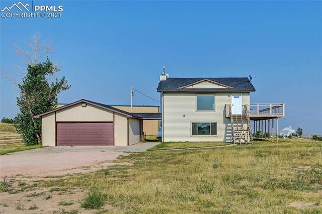 13055 Woodlake Road, Elbert, CO 80106 (#6960305) :: Tommy Daly Home Team