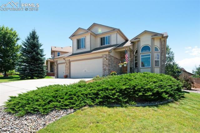 16258 Windy Creek Drive, Monument, CO 80132 (#6973651) :: The Treasure Davis Team