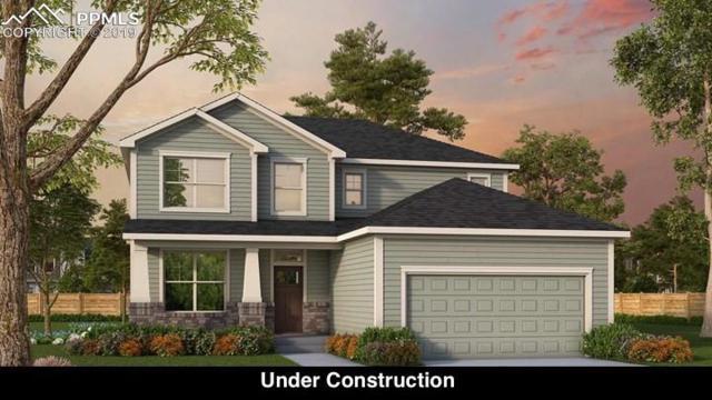 9646 Vistas Park Drive, Peyton, CO 80831 (#6985851) :: Fisk Team, RE/MAX Properties, Inc.
