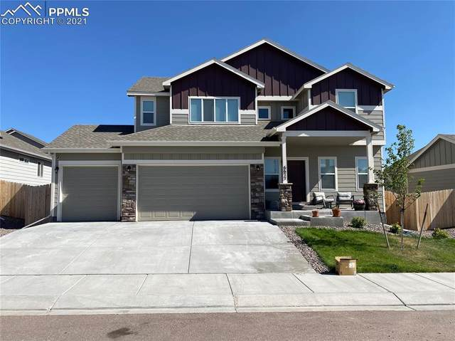 6677 Lamine Drive, Colorado Springs, CO 80925 (#7006414) :: Tommy Daly Home Team