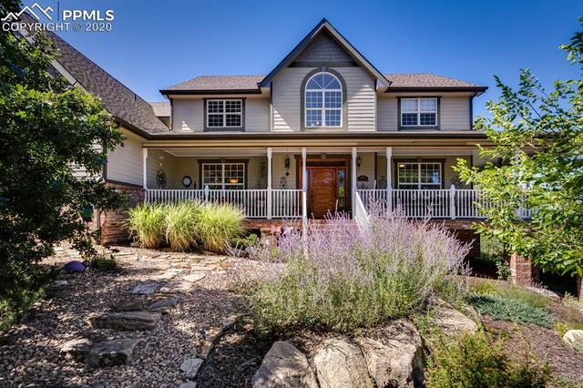 14385 Woodcrest Circle, Larkspur, CO 80118 (#7039996) :: Tommy Daly Home Team