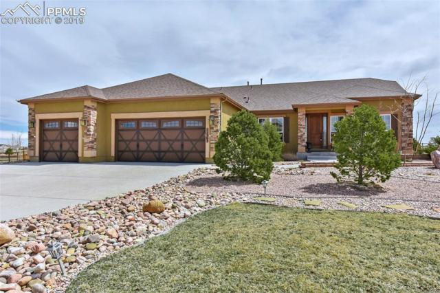 11363 Mt. Gateway Drive, Peyton, CO 80831 (#7056005) :: The Hunstiger Team