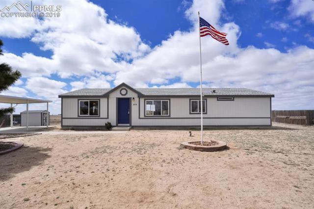 23775 Jayhawk Avenue, Colorado Springs, CO 80928 (#7058028) :: CENTURY 21 Curbow Realty