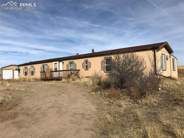 13335 Trail Boss Court, Peyton, CO 80831 (#7069460) :: Jason Daniels & Associates at RE/MAX Millennium