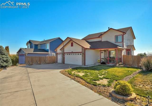 7134 Coral Ridge Drive, Colorado Springs, CO 80925 (#7208158) :: Symbio Denver