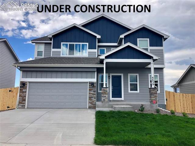 11126 Rockcastle Drive, Colorado Springs, CO 80925 (#7213210) :: The Treasure Davis Team
