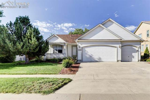 5063 Sacred Feather Drive, Colorado Springs, CO 80916 (#7241363) :: The Gold Medal Team with RE/MAX Properties, Inc