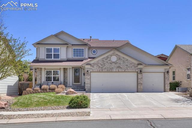 6727 Shimmering Moon Lane, Colorado Springs, CO 80923 (#7250219) :: The Hunstiger Team
