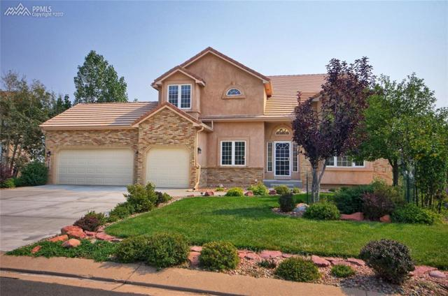 8415 Lauralwood Lane, Colorado Springs, CO 80919 (#7398712) :: The Hunstiger Team