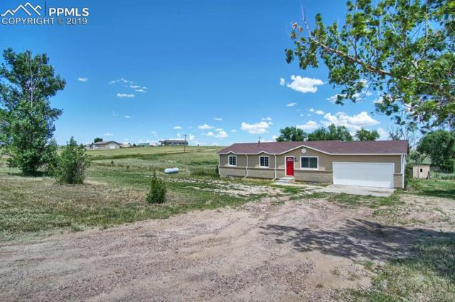 16775 Cathys Loop, Peyton, CO 80831 (#7541389) :: The Peak Properties Group