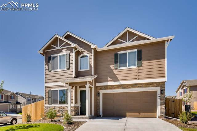 11498 Moonrock Heights, Peyton, CO 80831 (#7559877) :: Tommy Daly Home Team