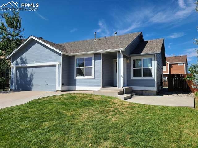 2040 Jeanette Way, Colorado Springs, CO 80951 (#7602120) :: Symbio Denver