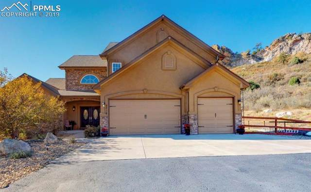 5716 Country Club Drive, Larkspur, CO 80118 (#7746915) :: Tommy Daly Home Team