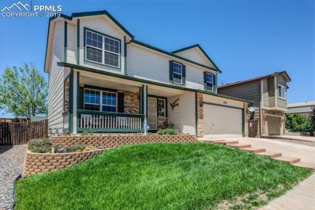 4912 Chariot Drive, Colorado Springs, CO 80923 (#7840173) :: The Hunstiger Team