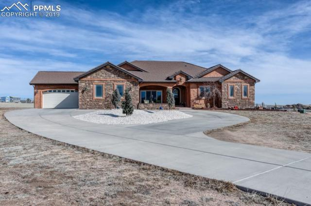 9325 Lochwinnoch Lane, Colorado Springs, CO 80908 (#7865990) :: The Hunstiger Team