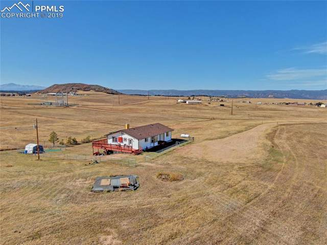4531 Best Road, Larkspur, CO 80118 (#7969383) :: Tommy Daly Home Team