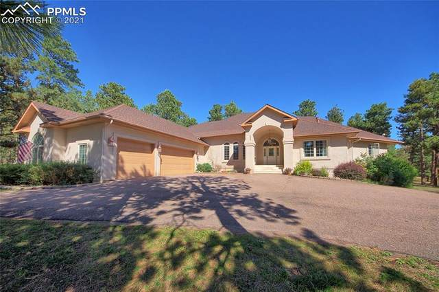 17950 Queensmere Drive, Monument, CO 80132 (#8046461) :: Tommy Daly Home Team