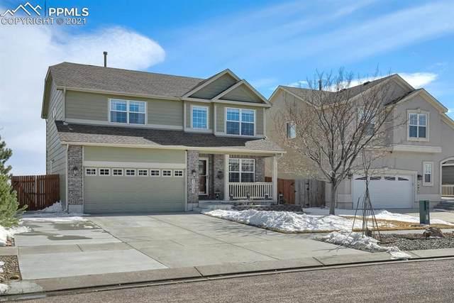 1695 Woodpark Drive, Colorado Springs, CO 80951 (#8095500) :: The Cutting Edge, Realtors