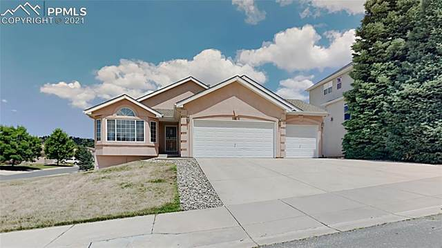 2310 Caddie Court, Colorado Springs, CO 80907 (#8130561) :: Tommy Daly Home Team