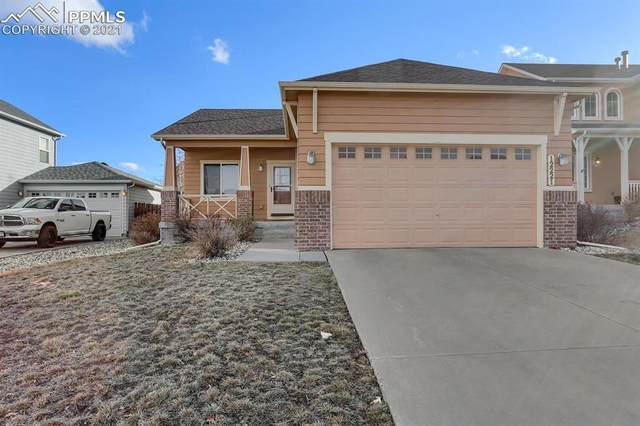 12221 Anacostia Drive, Peyton, CO 80831 (#8202513) :: Finch & Gable Real Estate Co.