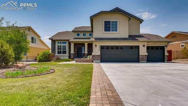 10958 Mount Evans Drive, Peyton, CO 80831 (#8246538) :: The Artisan Group at Keller Williams Premier Realty