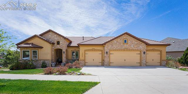 12254 Woodmont Drive, Colorado Springs, CO 80921 (#8247096) :: Action Team Realty
