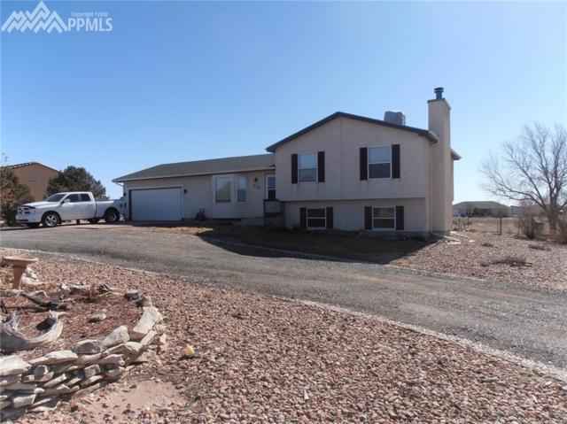 1296 W Caida Del Sol Drive, Pueblo West, CO 81007 (#8357717) :: The Treasure Davis Team