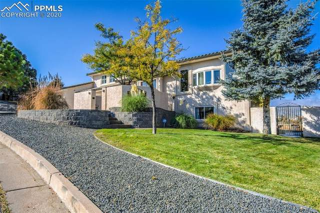 310 Sunbird Cliffs Lane, Colorado Springs, CO 80919 (#8383732) :: Tommy Daly Home Team