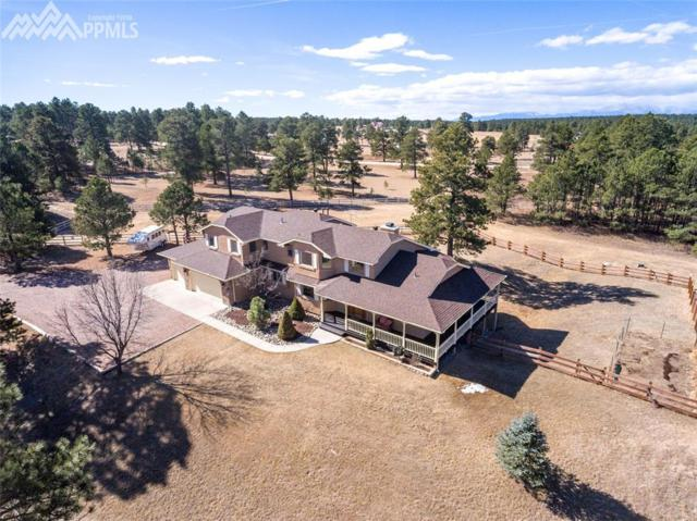 14950 E Coachman Drive, Colorado Springs, CO 80908 (#8423585) :: The Peak Properties Group