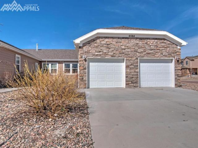 6584 Gelbvieh Road, Peyton, CO 80831 (#8518617) :: The Dunfee Group - Keller Williams Partners Realty
