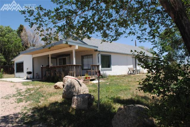 6040 Cowpoke Road, Colorado Springs, CO 80924 (#8637257) :: The Hunstiger Team