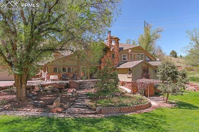 318 Oak Place, Manitou Springs, CO 80829 (#8703278) :: The Artisan Group at Keller Williams Premier Realty