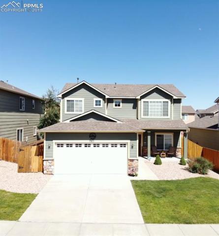 7871 Springwood Terrace, Colorado Springs, CO 80908 (#8754488) :: The Daniels Team