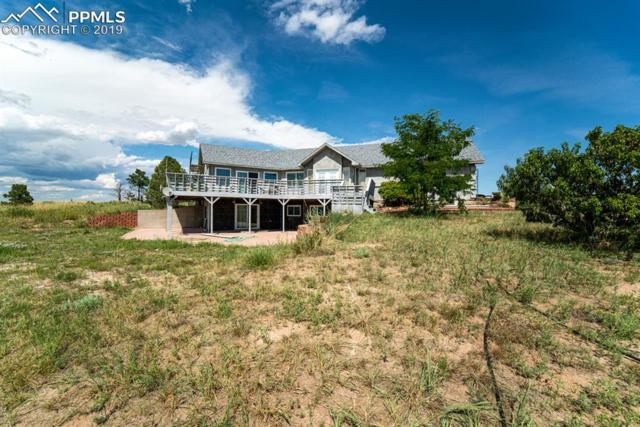 13550 Whistling Hills Lane, Colorado Springs, CO 80928 (#8781494) :: Jason Daniels & Associates at RE/MAX Millennium