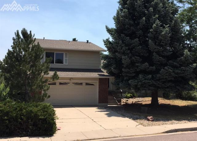 3225 E Oak Creek Drive, Colorado Springs, CO 80906 (#8791914) :: Action Team Realty