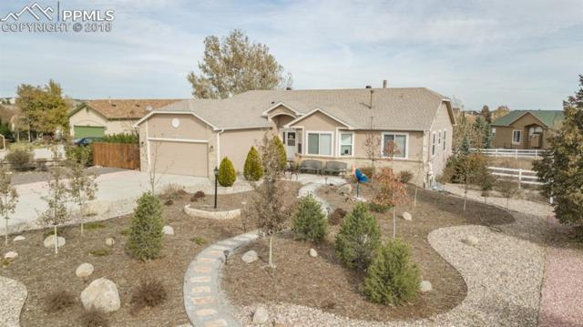 9915 Chasefield Court, Peyton, CO 80831 (#8844443) :: The Hunstiger Team